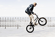 Germany, Schleswig Holstein, Teenage boy jumping with BMX bike - MSF002942