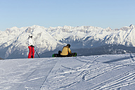Austria, Tyrol, Innsbruck, Stubai Alps, view to Axamer Lizum with two skiers in front - MABF000211