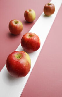 Red apples on pink background, close up - JTF000448