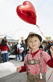 Germany, Bavaria, Munich, Portrait of boy with heart shaped balloon at Oktoberfest - ED000044