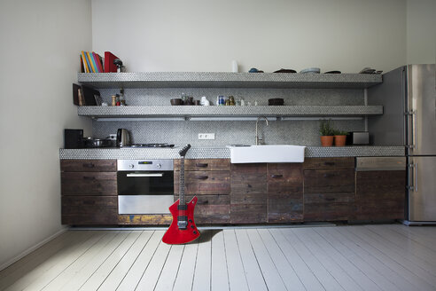 Interior of kitchen with electric guitar - FMKYF000349