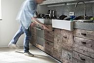 Mature man opening drawer - FMKYF000301