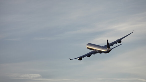 Germany, Bavaria, Munich, View of airbus a 340-600 departing at sunset - RDF001104