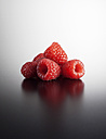 Raspberries on coloured background, close up - KSW001140