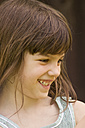 Germany, Baden Wuerttemberg, Girl smiling, close up - LV000122