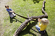 Germany, North Rhine Westphalia, Cologne, Boys playing in playground - FMKYF000403