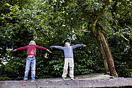 Germany, North Rhine Westphalia, Cologne, Boys playing in playground - FMKYF000408