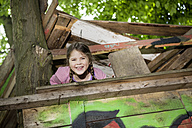 Germany, North Rhine Westphalia, Cologne, Girl playing in playground, smiling - FMKYF000379