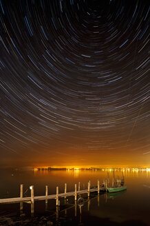 Germany, View of startrails above old jetty at night - SH000756