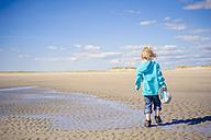 Denmark, Romo, Boy walking at North Sea - MJF000228