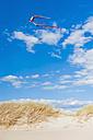 Denmark, Romo, Kite flying against sky at North Sea - MJF000263
