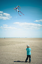 Denmark, Romo, Boy flying kite at North Sea - MJF000265