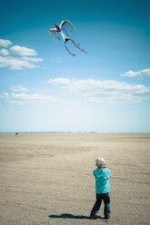 Denmark, Romo, Boy flying kite at North Sea - MJF000265