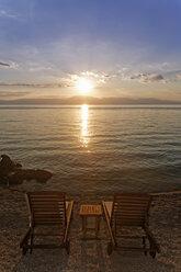 Croatia, Krk, Sunbeds at sunset in Njivice - GFF000051