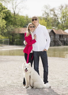 Germany, Bavaria, Portrait of couple standing with dog - CAF000017