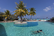 Asia, Maldives,View of young woman swimming in pool at Paradise Island - AM000580