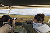 Africa,Kenya, Teenage girls taking picture at Lake Nakuru National Park - AM000617