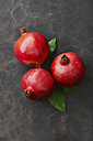 Pomegranates with leaf, close up - KSWF001153