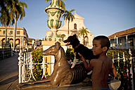 Cuba, Boy with dog standing at Plaza Mayor - PC000004