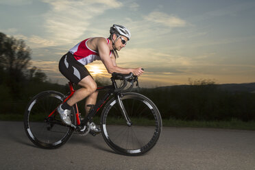 Germany, triathlete riding bicycle - STSF000049