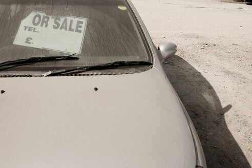 Portugal, Lisbon, Dusty car with old sales sign - SKF001316