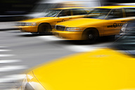 USA , New York, View of yellow taxi in motion - SK001424
