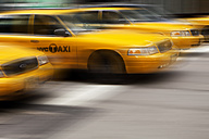 USA , New York, View of yellow taxi in motion - SKF001426