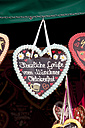 Germany, Bavaria, Munich, Decorated gingerbread hearts on Oktoberfest - SKF001353
