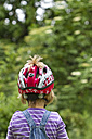 Germany, Kiel, Girl wearing bicycle helmet, close up - JFE000152