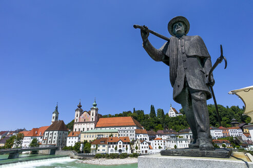 Austria, Upper Austria, Steyr, View of Statue with St Michael's Church in background - EJW000228