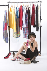 Girl fitting wardrobe of her mother, smiling - MAEF006919