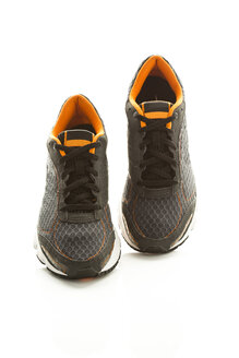 Pair of running shoes on white background, close up - MAEF006926