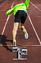 Germany, Young man running from sprint start - STSF000083
