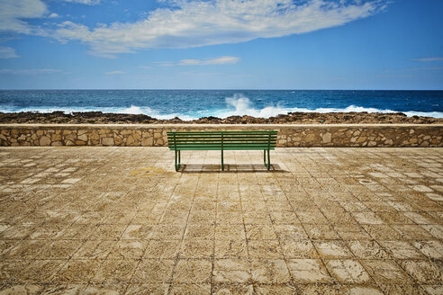 Italy, View of empty bench at beach - DIKF000041