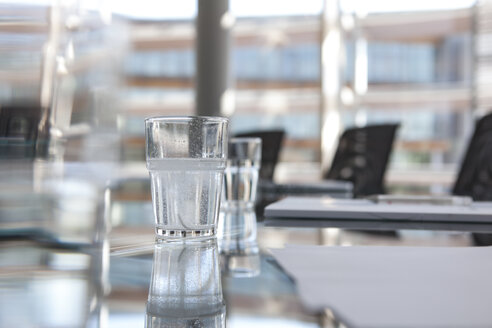 Glasses of water on conference room table - KFF000063