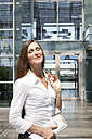 Businesswoman in front of office building - KFF000170