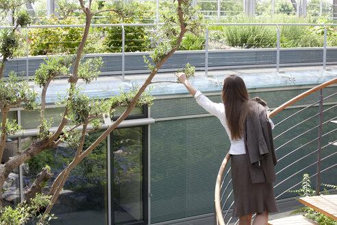 Businesswoman on spiral staircase - KFF000129