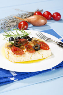 Feta, tomatoes, olives and rosemary in plate with fork - MAEF007018