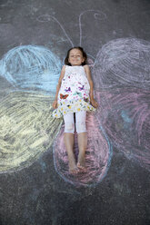 Little girl lying at street painting - SARF000083