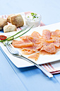 Smoked salmon on plate with napkin, close up - MAEF007133