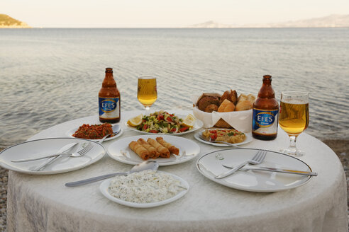 Turkey, Mixed appetizers with efes beer on table - SIE004223