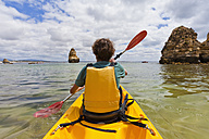 Portugal, Lagos, Teenage boy rowing Kayak - WDF001903