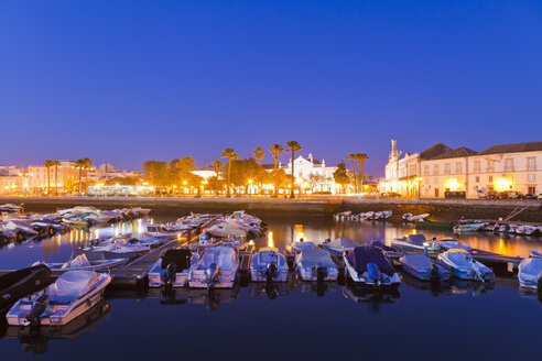 Portugal, Faro, Boats in harbour, old town in background - WDF001816