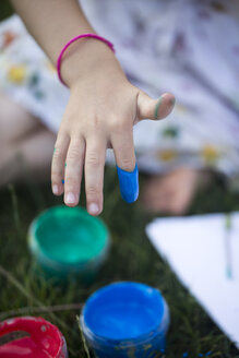 Germany, Bavaria, Girl hand with finger paint, close up - SARF000091