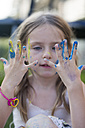 Germany, Bavaria, Girl playing with finger paint, close up - SARF000088