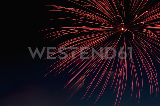 Germany, North Rhine Westphalia, Duesseldorf, Fireworks exploding in sky - KJF000248
