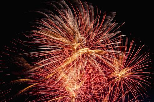 Germany, North Rhine Westphalia, Duesseldorf, Fireworks exploding in sky - KJF000241