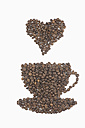 Coffee beans in shape of coffee cup with symbol of heart on white background - ASF005072