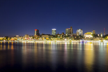 Germany, Hamburg, View of Landungsbrucken and skyline at Elbe River - NKF000013