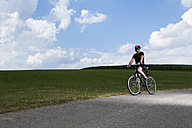 Germany, Bavaria, Mature man riding mountain bike - MAEF007146